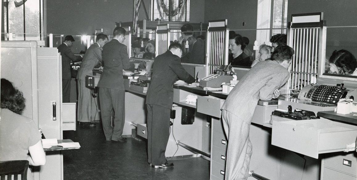 Photo of Ridgewood customers speaking to bank tellers