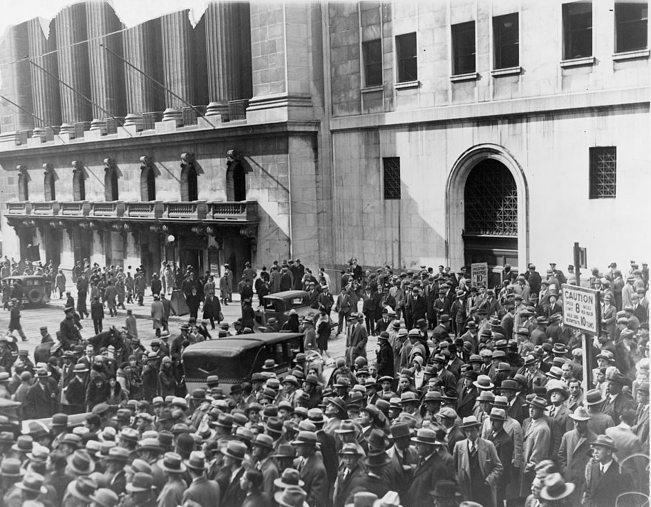 A crowd gathers outside after the stock market crash of 1929