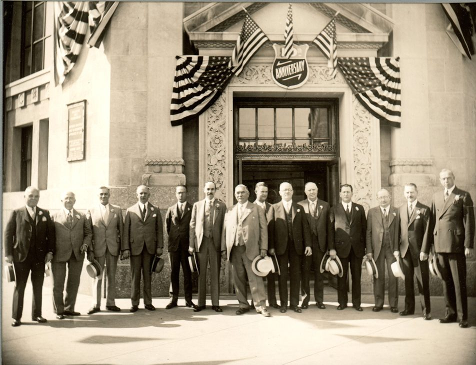 Ridgewood's founders stand in front of the bank's main office
