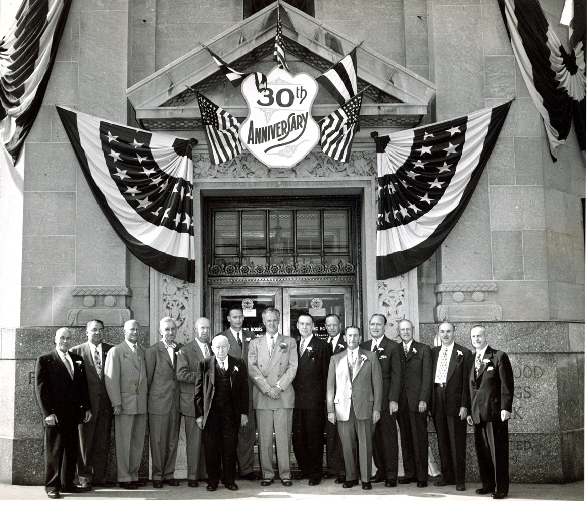 The bank's leadership stands in front of the main office on Ridgewood's thirtieth anniversary