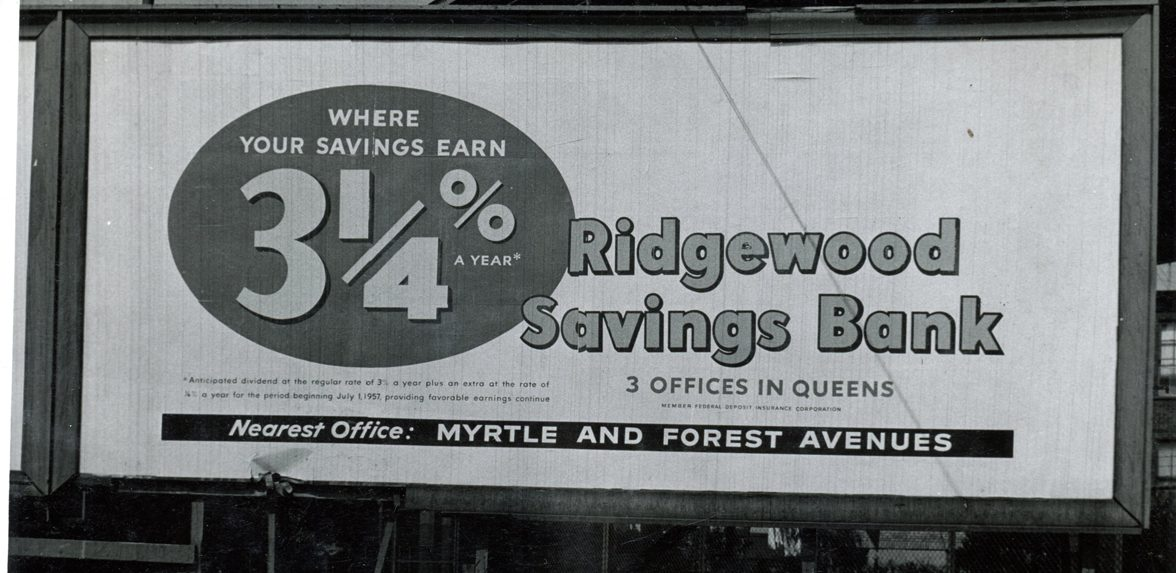 A billboard advertises a savings account interest rate of three and one-fourth percent