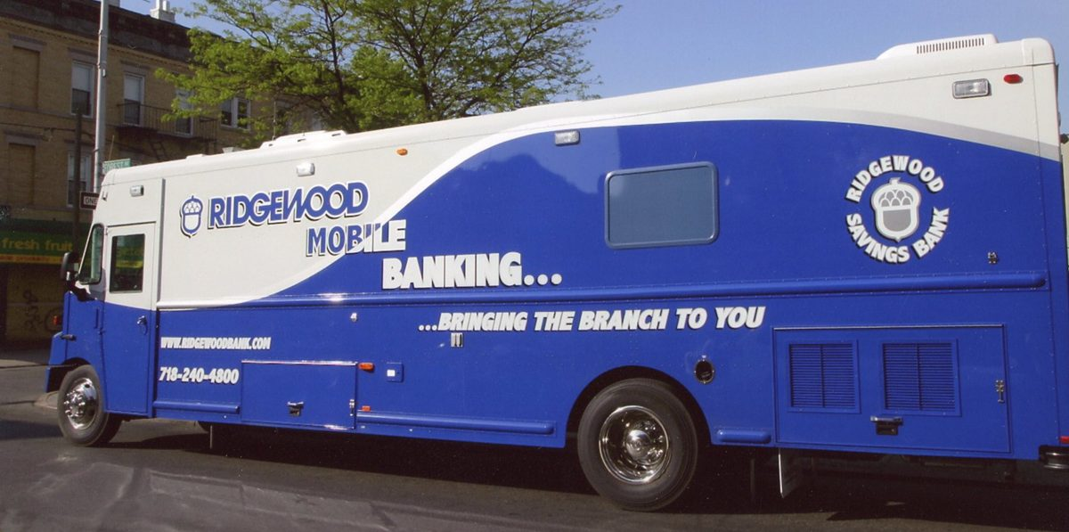 Ridgewood Savings Bank's Mobile Branch parked beside a building.