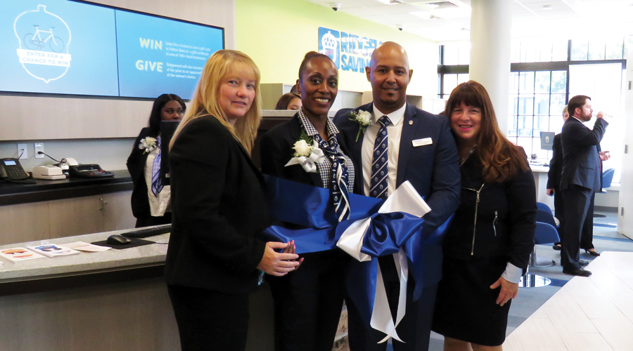 Employees celebrating a branch opening.