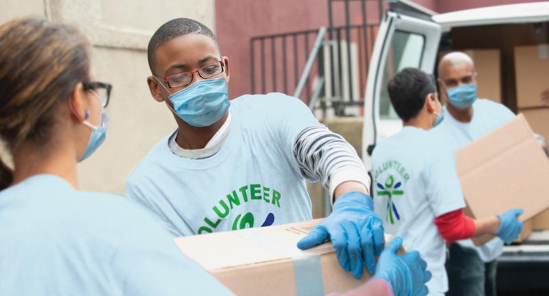 Volunteers prepping to deliver food.