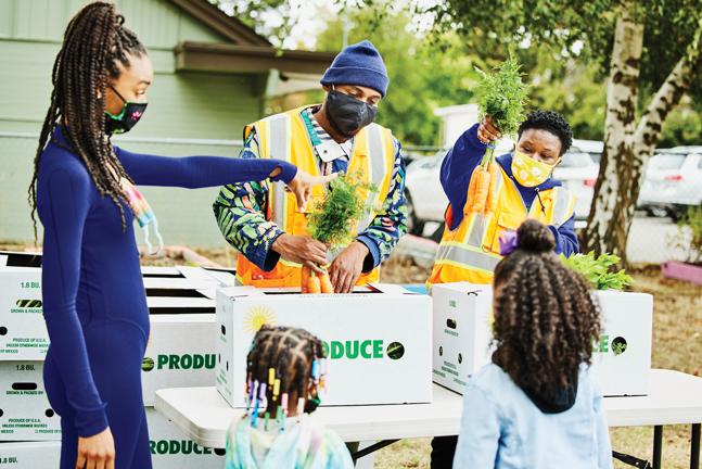 Volunteers handing out food.